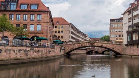 Nuremberg 2019. Pegnitz river flowing under the Fleischbrücke. We are a sunny summer morning. August 2019 in Nuremberg