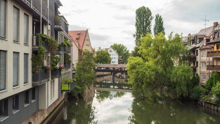 Nuremberg 2019. The Henkersteg, or Langer Steg, is a walkway that leads to the wooden hangman's tower on the Pegnitz river. We are a sunny summer morning. August 2019 in Nuremberg