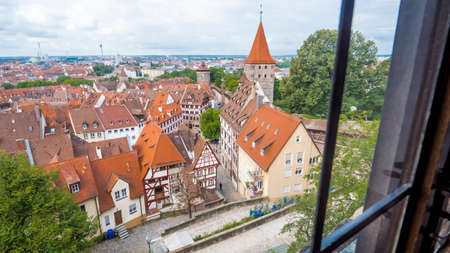 Nuremberg 2019. City roofs seen from a castle window. We are on a hot and cloudy summer day. August 2019 in Nuremberg