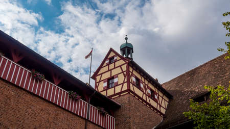 Nuremberg 2019. Part of the Castle with typical colored windows. We are on a hot and cloudy summer day. August 2019 in Nuremberg