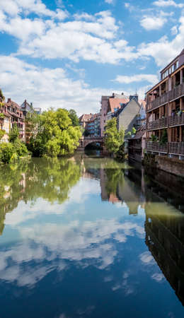 Nuremberg 2019. Palaces built on the banks of the Pegnitz River. We are on a hot and cloudy summer day. August 2019 in Nuremberg