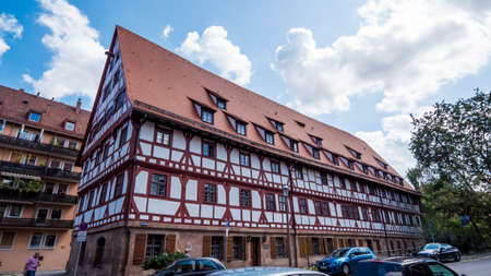Nuremberg 2019. Weinstadel House, old hostel for travelers and merchants recently renovated. We are on a hot and cloudy summer day. August 2019 in Nuremberg