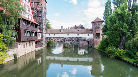 Nuremberg 2019. Hangman's Bridge, Henker brücke, on the Pegnitz River. We are on a hot and cloudy summer day. August 2019 in Nuremberg
