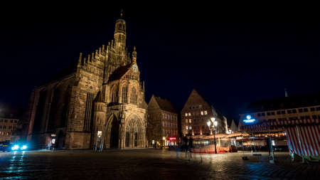 Nuremberg 2019. Tourists or ordinary citizens strolling in front of the Frauenkirche, or church of our lady. We are on a warm summer evening. August 2019 in Nuremberg