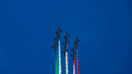 Italy 2020: Frecce Tricolori, Italian acrobatic patrol, uphill vertically. Green, white and red trails are on. Event on the occasion of the Republic Day. June 2020, Rome Editorial