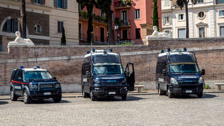 Italy 2020: Stationary vans of the Carabinieri near a socio-political event. We are in a morning in June and not far away there are politicians who perform a rally. June 2020, Rome