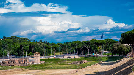 Italy 2020: Esplanade of the Circus Maximus. We are at the end of spring, the sky is clear and there are clouds. June 2020, Rome