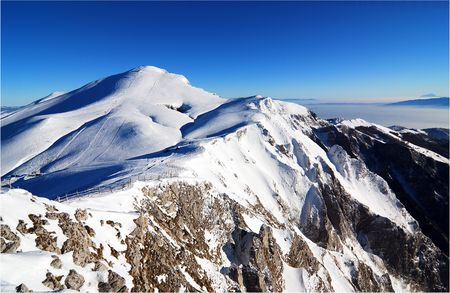 mountainscape: Winter Season on Snowy Mountain Peaks