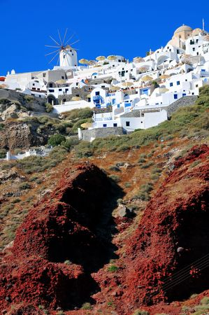 ios: The village of Oia hanging from the volcanic cliffs of Santorini island Greece