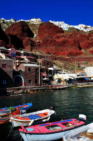 The village of Oia hanging from the volcanic cliffs of Santorini island Greece photo