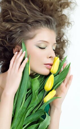 verdure: girl beautiful tulips yellow flowers verdure fresh  Stock Photo