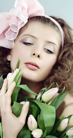 airiness: Beautiful woman with the bouquet of pink it is flowers. Pastel tulips.
