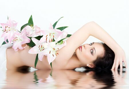 Beautiful woman with the pink flowers in the water. Stock Photo - 4690806