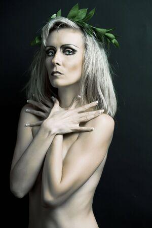 Portrait of woman against the black background. photo