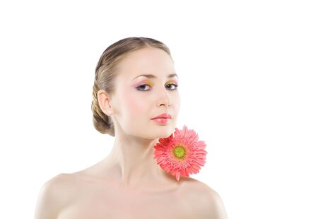 Woman with a pink flower on a white background. photo