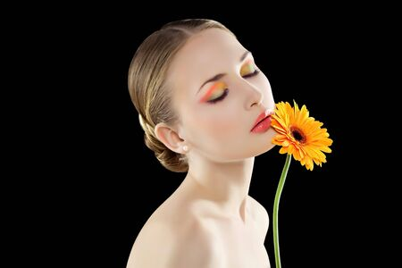 Relaxing Woman with an orange flower. photo
