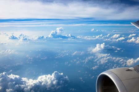 Clouds and sky as seen through window of an aircraft. View from the passenger plane window. Archivio Fotografico