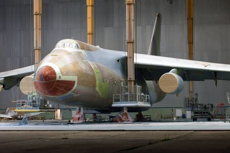 Passenger aircraft in the hangar during maintenance and painting