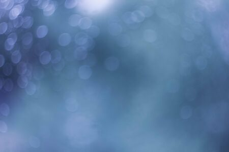 Abstract blue background with bokeh. Texture. Defocusing.