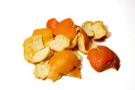 Food waste tangerine on a white background. Isolate. Close up. Waste for recycling. Responsible disposal of household food wastage in an environmentally friendly way by recycling. Stock Photo