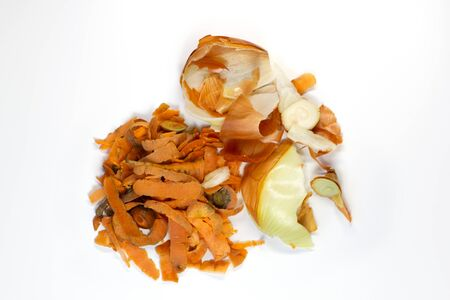 Food waste carrot, onion on a white background. Isolate. Top view. Flat lay. Waste for recycling. Responsible disposal of household food wastage in an environmentally friendly way by recycling. Stock Photo