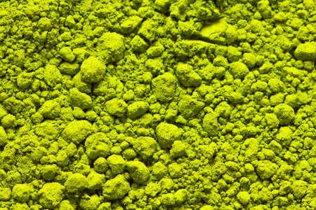 Powdered green tea matcha close-up. Texture of matcha tea macro background. Copy space. Top view. 免版税图像