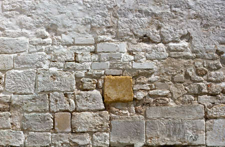 White old brick wall. Texture of a white antique stone wall. Grunge texture white brick background. Copy space.