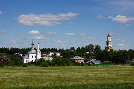 Landscape in Suzdal. Beautiful nature in Suzdal. View of the Bell Tower of the Rizopolozhensky Monastery, the Epiphany, the Nativity Church.