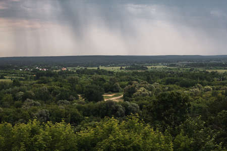 Beautiful summer landscape from the observation deck in Vladimir. Nature of Russia. Russian landscape in cloudy weather. The city of Vladimir - top view. 免版税图像