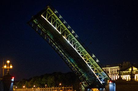 Troitsky Bridge in Saint Petersburg at night. Drawbridges of St. Petersburg. Close-up.