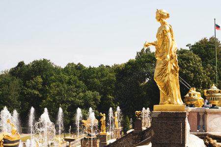 Saint Petersburg, Russia, July 2021: Golden statue of Juno in Peterhof. Side view.