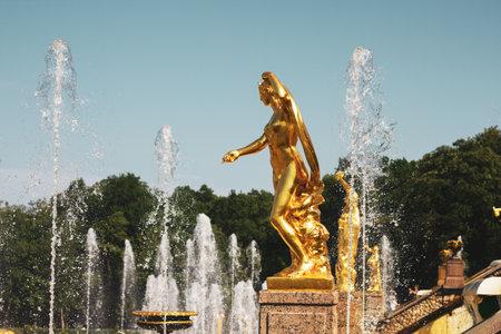Saint Petersburg, Russia, July 2021: Golden statue of Galatea in Peterhof. 新闻类图片