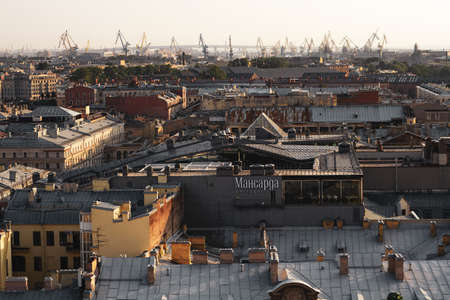 Top view of the city of St. Petersburg and construction cranes. View from the colonnade of St. Isaac's Cathedral in St. Petersburg. Panorama of St. Petersburg. 新闻类图片