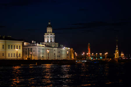 Kunstkammer in St. Petersburg at night. Night landscape of St. Petersburg. View of the Kunstkamera and rostral columns at night.