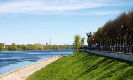 TVER, Russia, May 2021: Stepan Razin Embankment on the Volga river in Tver. View of the bridge from the Volga River embankment on a sunny day.