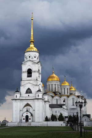 Russia, Vladimir, June 2021: Bell tower of the Assumption Cathedral in Vladimir in cloudy weather. 新闻类图片