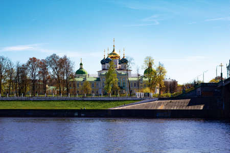 TVER, Russia, May 2021: View of the Imperial Travel Palace and the church in Tver. The embankment of Stepan Razin in Tver.