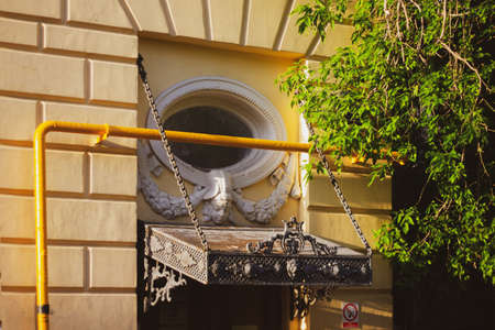 An old entrance visor of the 19th century. Architecture of the 19th century in Moscow. Entrance to the building is decorated in the style of classicism of the 19th century