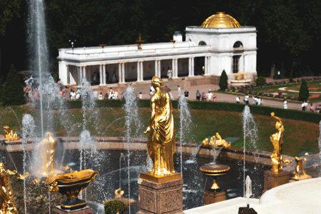 Saint Petersburg, Russia, July 2021: Golden statue of Juno in Peterhof. Rear view.