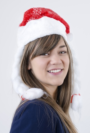 beautiful girl with pretty teeth,brown hair and New Year s cap on her head smiling photo