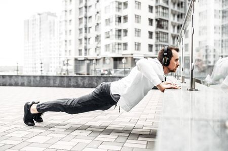 Stretching outdoors. A young man is warming up before workout