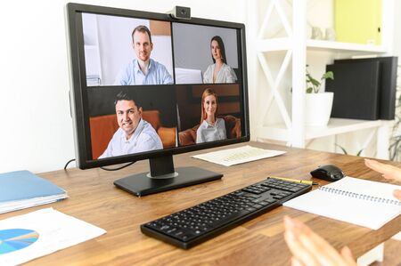 Close up pc screen with video conference on the table. Video call, video meeting