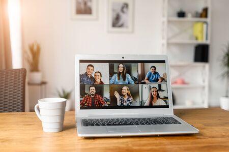 Using zoom app for distance video communication with coworkers, friends. People profiles on laptop desktop. Online meeting, webinars