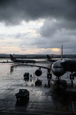 In airport. A huge airplane with an amazing cloudy sky on the background