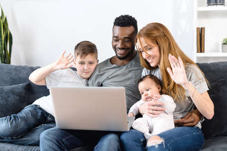A multiracial family on the couch at home Stock Photo