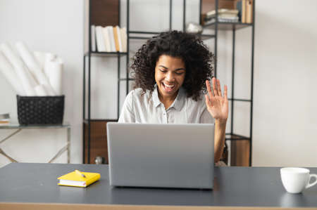 Video call concept. young cheerful woman is using a laptop for video connection, remote meeting. Banque d'images