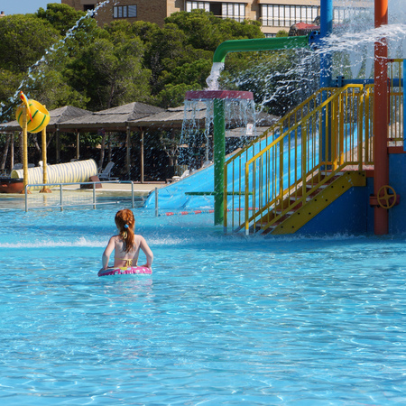 red hair girl behind view in outdoor aquapark Stock Photo
