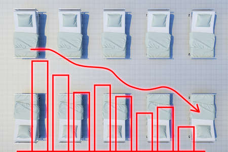 rows of hospital beds top view with chart shows decline. 3d rendering 免版税图像