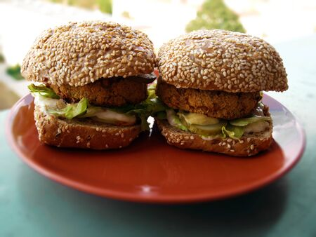 vegetarian or vegan delicious burgers on the plate. Healthy fitness veggie eating. Фото со стока