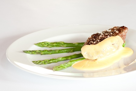 Steak with Dijon sauce and asparagus  photo